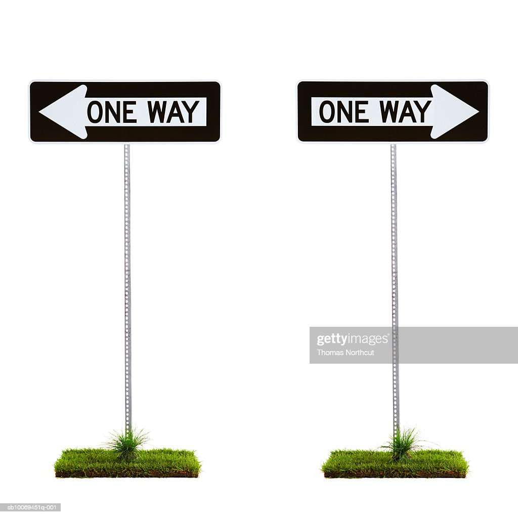 Two one way signs pointing to opposite directions : Stock Photo