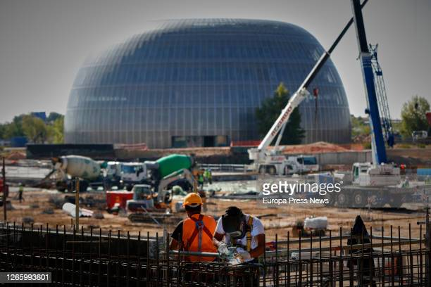 Two operators are seen working on the construction site of the Isabel Zendal Emergency Hospital, located in the Valdebebas neighborhood, to attend in...