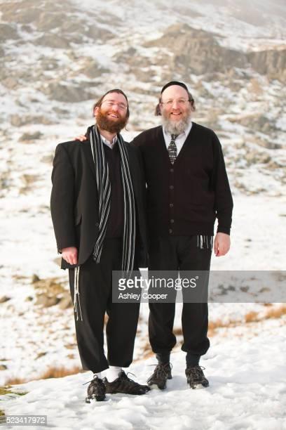 two orthodox jewish men pose for a photograph - ラビ ストックフォトと画像