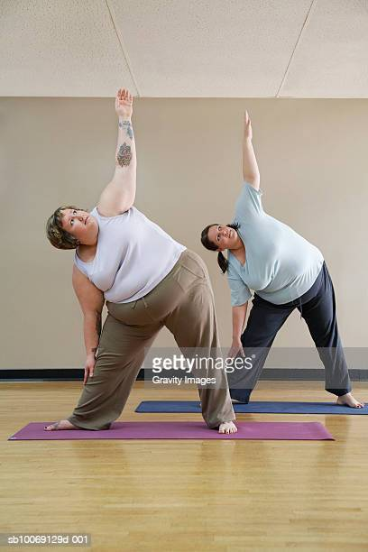 Two overweight women exercising