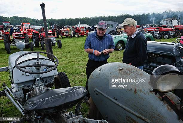 Two owners discuss their vintage tractors at the annual Duncombe Park Steam Fair on July 3 2016 in Helmsley England Held in the picturesque grounds...