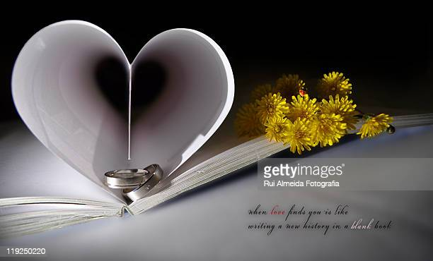 Two pages in open book creating  heart