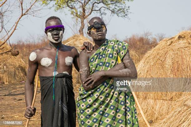 Two painted and scarred warriors of the Mursi tribe in the Mago National Park near Jinka, Debub Omo Zone, Southern Ethiopia, Africa.
