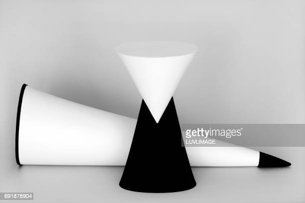 Two painted conic forms, one vertical, one horizontal.