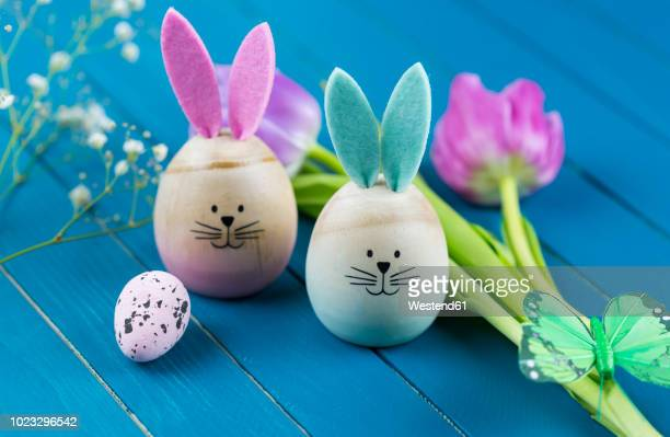 two painted easter eggs with rabbit ears - easter bunny stock pictures, royalty-free photos & images