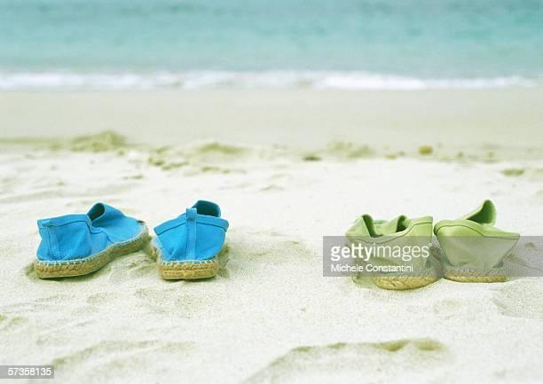two pairs of espadrilles on beach - espadrilles foto e immagini stock