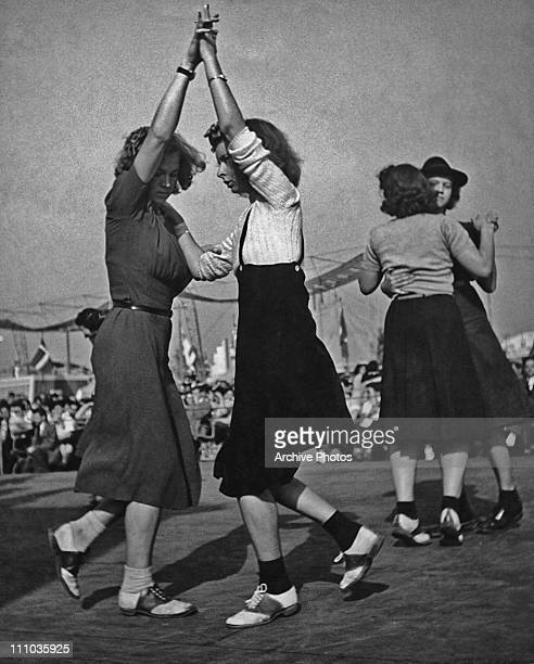 Two pairs of female jitterbug dancers at the World's Fair New York 1939