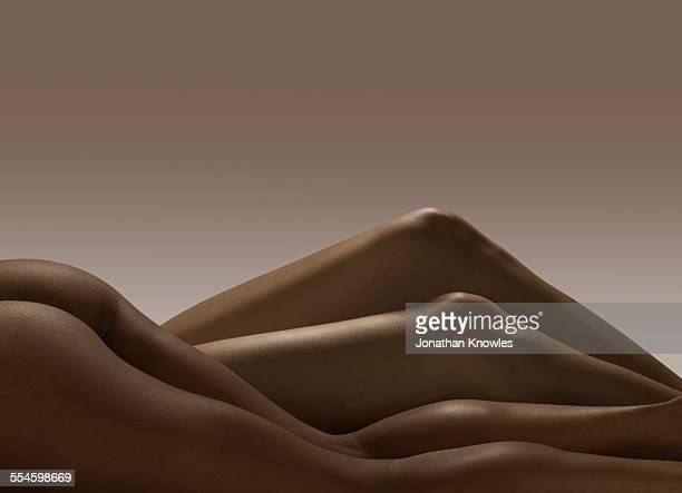 two pairs of nude female legs - beautiful bare bottoms stock pictures, royalty-free photos & images