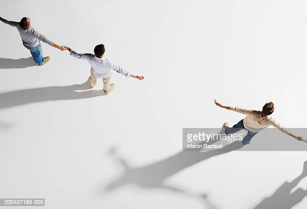 two pairs of people holding hands, gap between pairs, overhead view - human arm stock pictures, royalty-free photos & images