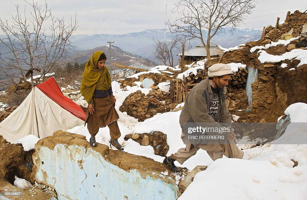 Two Pakistani survivors leave their tent & Two Pakistani survivors leave their tent Pictures | Getty Images