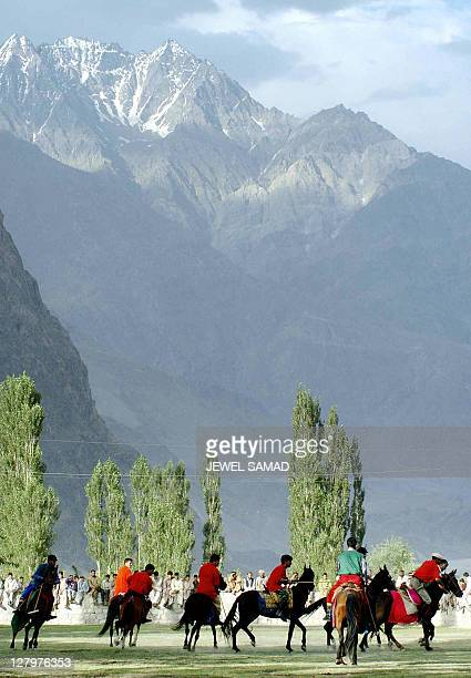 Two Pakistani tribal polo teams play a match as a part of celebration of the golden jubilee of the first ascent of K2, the second higest peak of the...