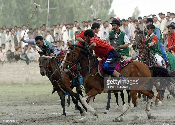 Two Pakistani tribal polo teams play a match as a part of celebration of the golden jubilee of the first ascent of K2 the second highest peak in the...