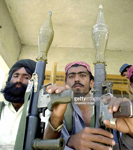 Two Pakistani tribesmen sit holding their Rocket Propelled Grenade launders in Dera Bugti some 650 kilometers southwest of Islamabad 28 March 2005...