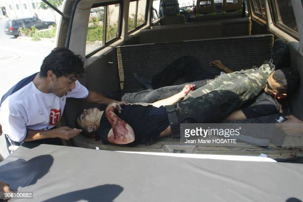 Two Palestinian militants lie in the back of a vehicle after they were killed by Israeli troops in the southern Gaza strip June 20 2007 Israeli...