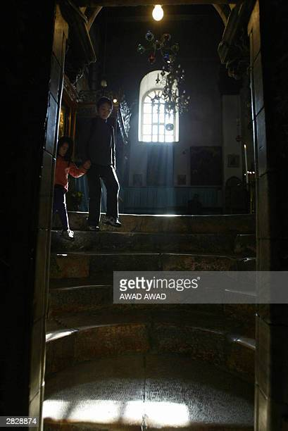Two Palestinians make their way down the stairs leading into the Grotto the alleged birth place of Jesus Christ in the Church of the Nativity in the...