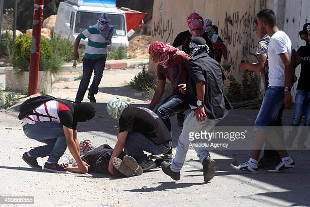 Two Palestinians were killed in clashes with Israeli army forces in the West Bank city of Ramallah on May 15 2014 as thousands of Palestinians...