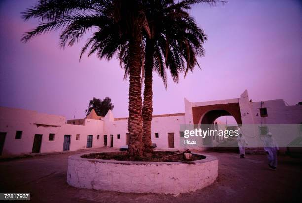 Two palm trees stand in the middle of the Market Square April 2000 in Ghadames Libya