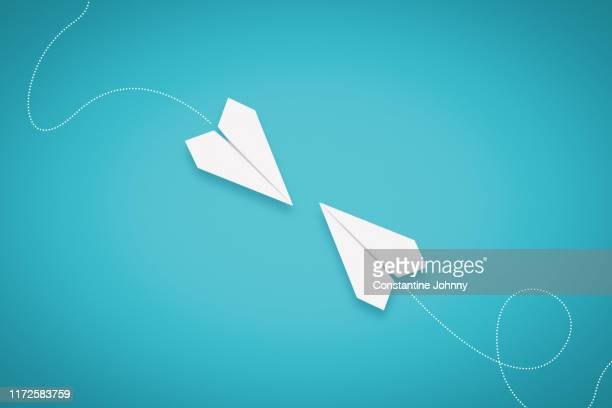 two paper airplanes facing each other - teal stock pictures, royalty-free photos & images