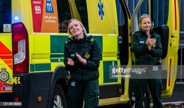 Two paramedics clapping outside Harrogate Hospital as they take part in Clap for our Carers.