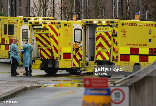 Two paramedics seen near ambulances parked outside the A and E department at the the Mater Misericordiae University Hospital in Dublin, during...