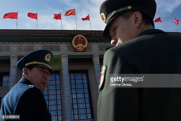 Two paramilitary officers arrive at the Great Hall of the People before the 2nd plenary session of the National People's Congress on March 9, 2016 in...