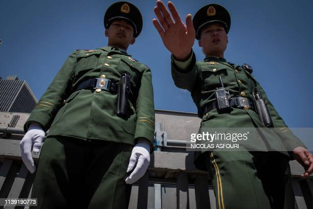 TOPSHOT Two paramilitary police officers secure an area along a street during the Belt and Road Forum in Beijing on April 25 2019