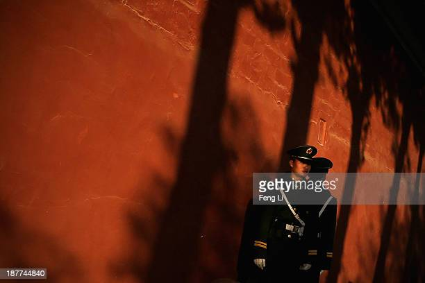 Two paramilitary policemen guard outside the Great Hall of the People where the Communist Party's 205member Central Committee gathered for its third...