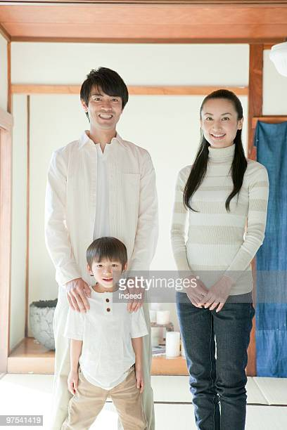 Two parents and son(4-5) portrait, smiling