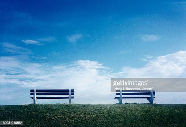 Two Park Benches on Horizon
