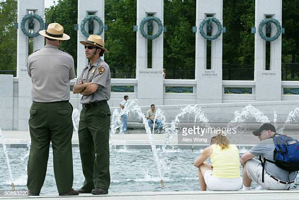 Two park rangers stand guard at the National World War II Memorial May 24, 2004 in Washington, DC. Thousands of veterans are expected to join a...
