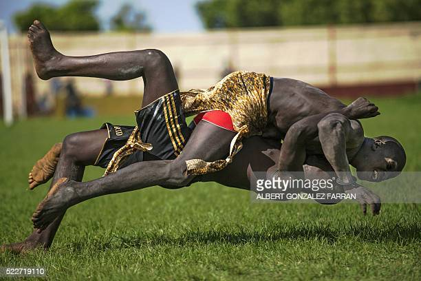 Two participants from Imatong and Terekeka counties take part of the South Sudan National Wrestling Competition for peace at Juba Stadium on April 20...