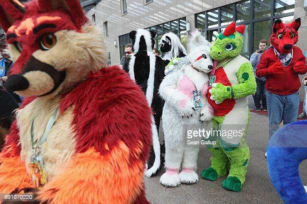Two participants or furries as they prefer to be called pause for a tender moment after dancing to flashmob tunes upon their arrival the Estrel Hotel...