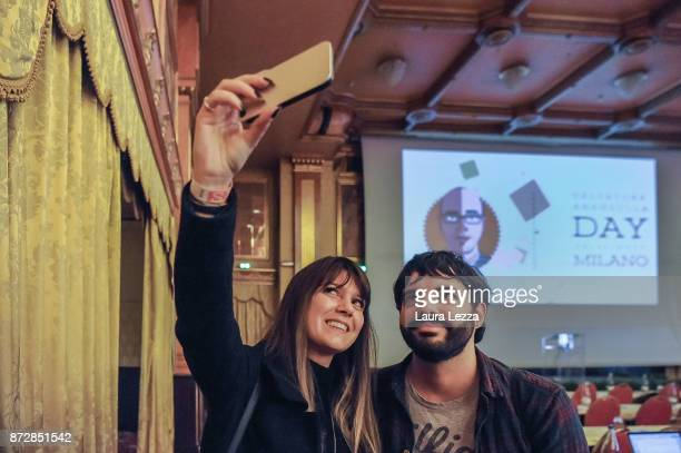 Two participants take a selfie photo after the Italian digital entrepreneur founder of Aranzullait web site and spreader of IT concepts Salvatore...
