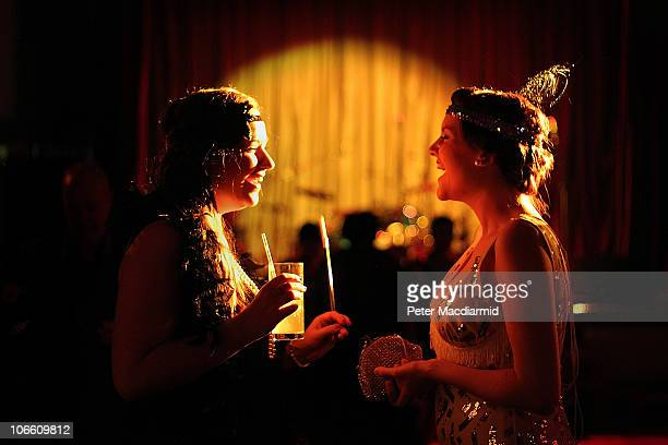 Two party goers dressed as flapper girls talk together at the 'Prohibition' 1920's themed night on November 6 2010 in London England Guests dressed...