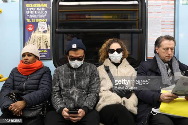 Two passengers of the subway are wearing a protective mask on February 26, 2020 in Milan, Italy. The country is struggling to understand how it went...