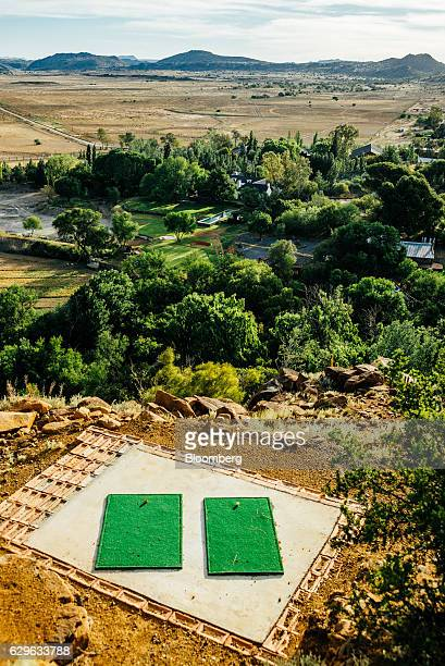 Two patches of artificial grass for golf driving stands on a hill in the grounds of the Rietfontein ranch and stud farm in Karoo Colesberg South...