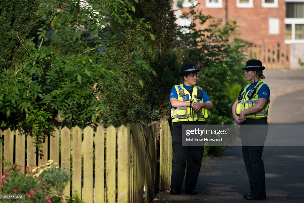 Two PCSO's stand outside a property during a search of a house on Glyn Rhosyn, Pentwyn, which is believed to be the home of Darren Osborne, who has been named as the man responsible for the Finsbury Park Mosque attack, on June 19, 2017 in Pontyclun, Wales. A van ploughed into pedestrians near Finsbury Park Mosque on Severn Sisters Road, North London, at around 12.20 this morning. Police have reported that one man was killed and nine people were injured. 47-year-old Darren Osborne has been arrested on suspicion of carrying out the attack. Prime Minister Theresa May has said police are treating it as a potential terrorist incident.