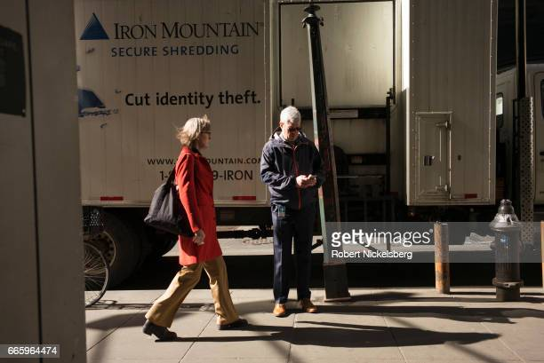 Two pedestrians prepare to meet on a sidewalk March 30 2017 in New York City There are 12750 miles of public sidewalks in New York City