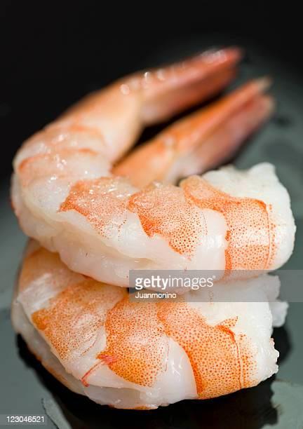 Two peeled shrimps