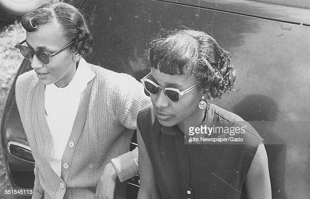 Two people a Morgan College student and an alumni women students at the AfricanAmerican state college Baltimore Maryland 1952