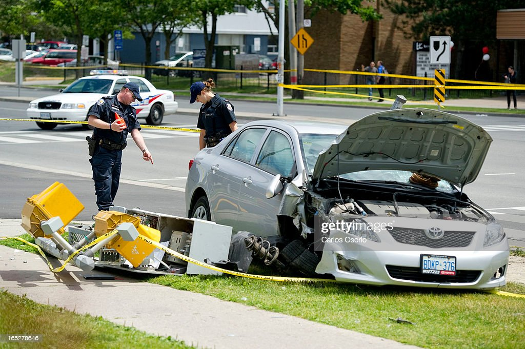 Two people are dead after a car mounted the sidewalk and hit three pedestrians near Bathurst St. and : News Photo