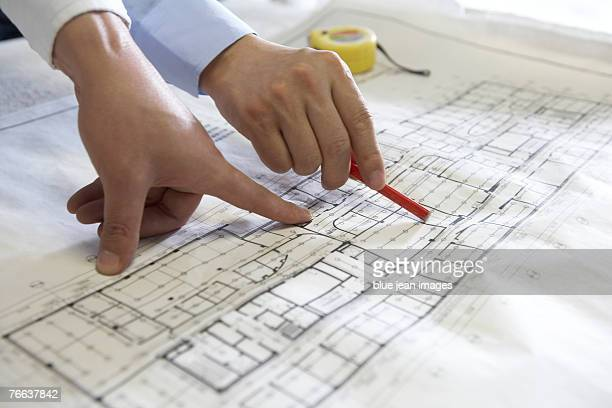 Two people are examining the floor plan.
