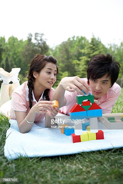 Two people are playing blocks.