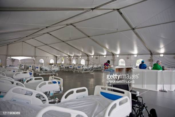Two people are seen inside the provisional hospital set up during the COVID-19 novel coronavirus pandemic at the parking lot of the Regional...