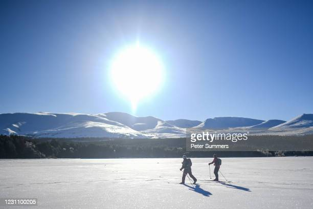 Two people are seen skiing on Loch Morlich after it froze on February 11, 2021 in Aviemore, United Kingdom. The village of Carrbridge in Badenoch and...