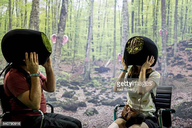 Two people are testing virtual reality helmets during day 1 of Sonar Festival 2016 on June 16 2016 in Barcelona Spain