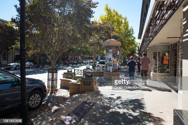 Two people are visible from behind walking down Castro Street in the Silicon Valley town of Mountain View California October 28 2018