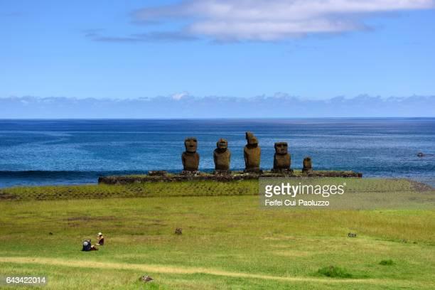 Two people at Ahu Tahai Moai site of Hanga Roa in Easter Island of Chile