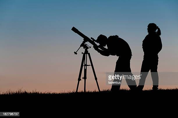 Two people at an astronomy club observing night