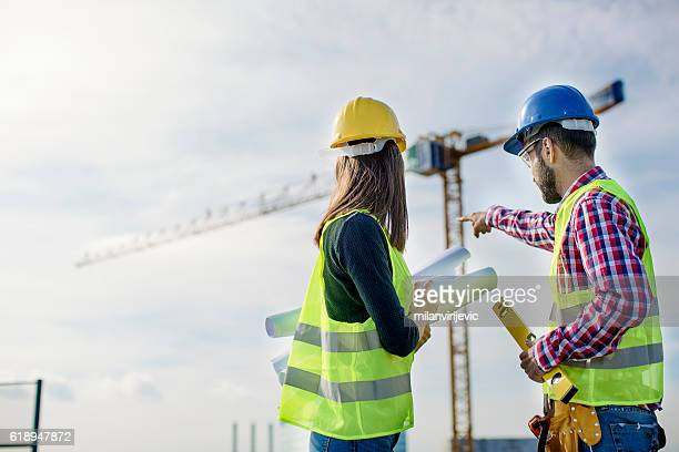 Two people at construction site